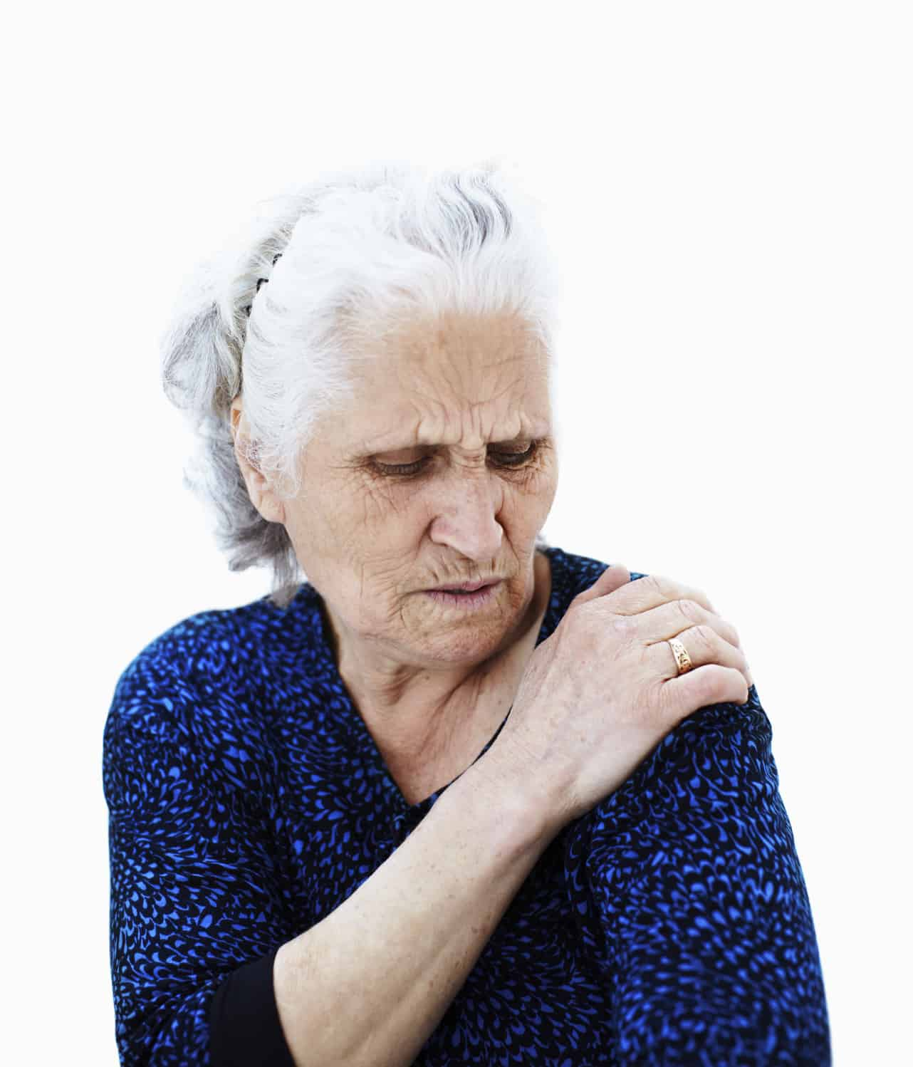 Senior woman holding her shoulder in pain